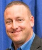 Officer John Thomas was reportedly sprayed with mace before he shot a 55-year-old Patrick Bauer multiple times.