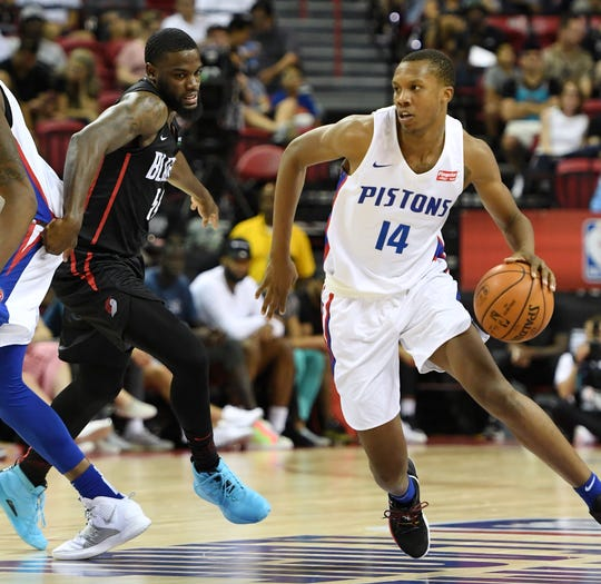 Pistons forward Louis King brings the ball up the court against the Blazers' Keljin Blevins during the 2019 NBA Summer League at the Thomas & Mack Center on Saturday, July 6, 2019 in Las Vegas.