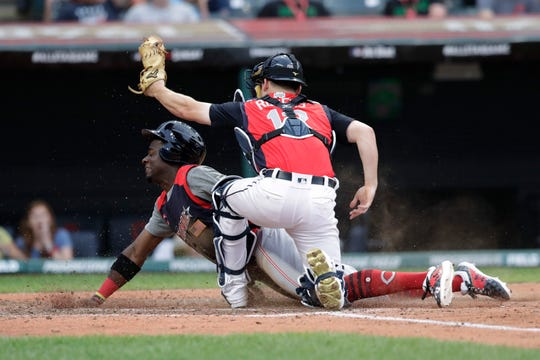 Taylor Trammell, of Cincinnati Reds, is tagged out by Jake Rogers, of the Detroit Tigers, during the fourth inning of the MLB All-Star Futures baseball game on July 7, 2019, in Cleveland.