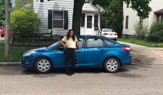Shelby Booth saved up for a 2012 Ford Focus to commute to Michigan State University from her home in Mio.