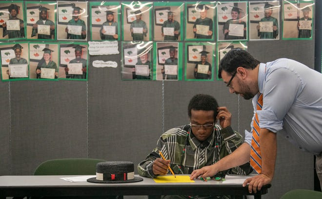 Stephen Gray, 25, of Detroit, left, gets help from tutor and mentor Anthony Tejada of Allen Park Wednesday, July 3, 2019, as he studies to take his GED. Photographed for a story by Angie Jackson, a Report for America corps member at the Free Press.