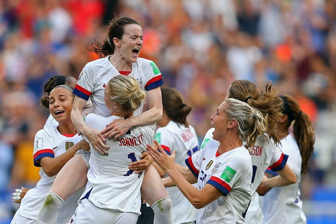 In Lyon, France, Rose Lavelle of the USA celebrates with teammates following the 2019 FIFA Women's World Cup France Final match between The United States of America and The Netherlands at Stade de Lyon on July 07, 2019 in Lyon, France. (Photo by Richard Heathcote/Getty Images)