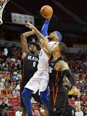 Pistons guard Bruce Brown drives to the basket between the Blazers' Nassir Little, left, and Zach Auguste during the 2019 NBA Summer League at the Thomas & Mack Center on Saturday, July 6, 2019 in Las Vegas.