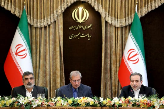 From left to right, spokesman for Iran's atomic agency Behrouz Kamalvandi, Iran's government spokesman Ali Rabiei and Iranian Deputy Foreign Minister Abbas Araghchi, attend a meeting in Tehran, Iran, Sunday, July 7, 2019.