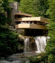 This Aug. 23, 2007, file photo, visitors gather on one of the cantilevered terraces at Fallingwater, a Frank Lloyd Wright design in Bear Run, Pa.