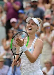 Alison Riske celebrates defeating Ash Barty in a women's singles match.