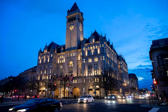 In this Jan. 23, 2019, file photo, the Trump International Hotel near sunset in Washington. The Justice Department is challenging a District of Columbia federal judge's decision allowing a case accusing President Donald Trump of profiting off the presidency to go forward. Justice lawyers want an appeals court to take the case instead.