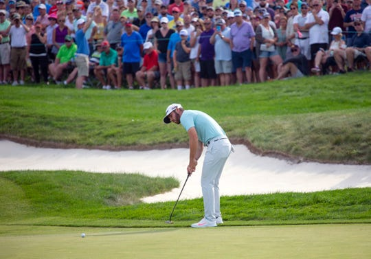 Matthew Wolff putts for eagle on the 18th hole to win during the final round of the 3M Open on Sunday.
