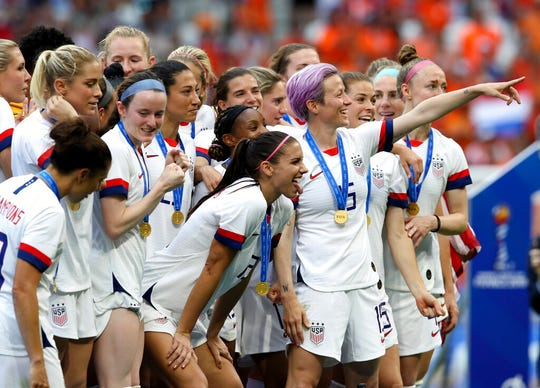 United States' Megan Rapinoe, center, celebrates team's victory with teammates after the Women's World Cup final soccer match between US and The Netherlands at the Stade de Lyon in Decines, outside Lyon, France, Sunday, July 7, 2019. US won 2:0.