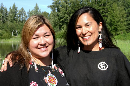 "In this June 19, 2019, photo, Rochelle Adams, left, an Alaska Native cultural advisor, and Princess Johnson, the creative producer for the series ""Molly of Denali"" appear at the Alaska Native Heritage Center in Anchorage, Alaska. The animated show, which highlights the adventures of a 10-year-old Athabascan girl, Molly Mabray, premieres July 15 on PBS Kids."