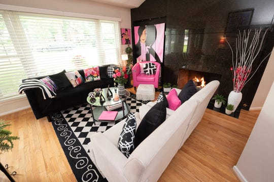 A hot pink chair anchors the living room at the home of Carolyn Krieger, in Sylvan Lake.