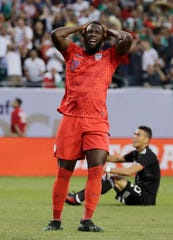 United States forward Jozy Altidore reacts after missing a shot against Mexico during the first half of the CONCACAF Gold Cup final match at Soldier Field in Chicago on Sunday.