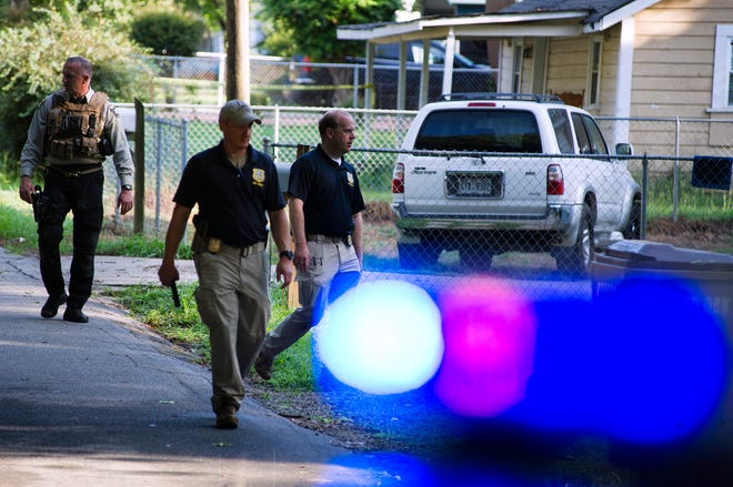 Georgia Bureau of Investigation agents and Hall County Sheriff's Office deputies work a crime scene along Highland Avenue, Monday, July 8, 2019, in Gainesville Ga., where a Hall County Sheriff's deputy was shot the night before.