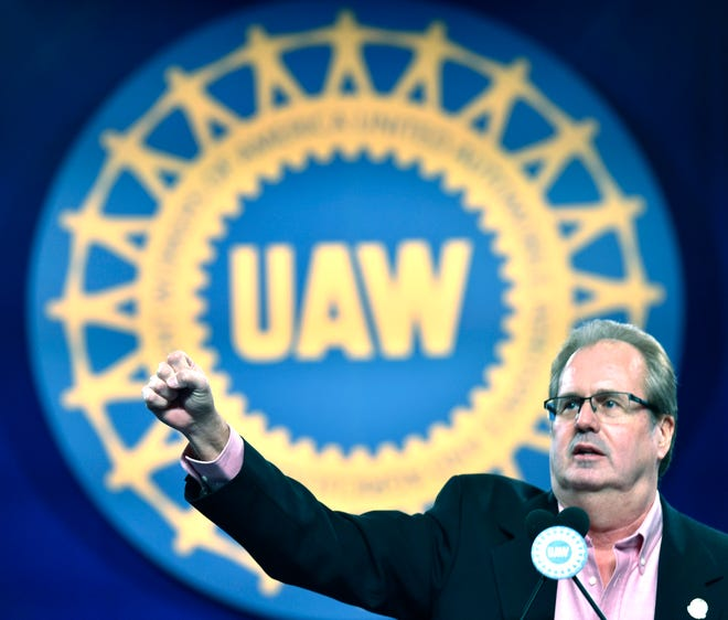 United Auto Workers President Gary Jones fires up delegates as he starts the chant, 'We Are One.' He is now on unpaid leave, implicated in the federal corruption investigation.