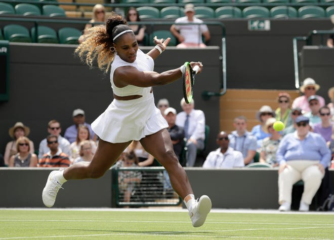 Serena Williams returns the ball to Carla Suarez Navarro in a women's singles match Monday.