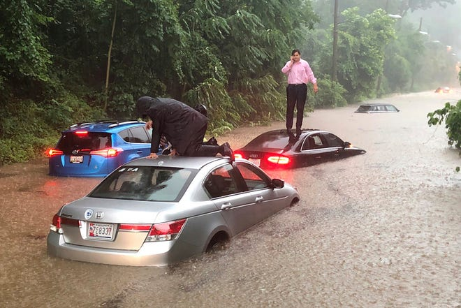 Motorists are stranded on a flooded section of Canal Road in Washington during a heavy rainstorm, Monday, July 8, 2019.