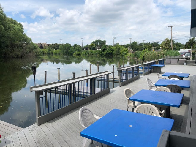 A riverside patio at Miles on the Water can seat about 70 guests, and has a tiki bar and a few boat docks.