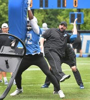 Matt Patricia works with players during a minicamp practice in June.