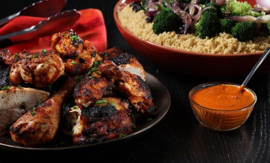 Grilled chicken with harissa sauce and couscous, prepared and styled by Shannon Kinsella, in the test kitchen,