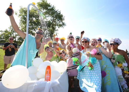 A creative idea and spark allowed a group of 21 friends to pull together a bubble bath-themed toga squad for the Finger Lakes Wine Festival's Launch of the Lakes celebration in 2015.