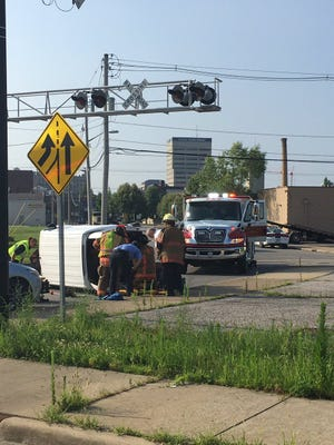 Two people were hurt in a rollover crash at First Avenue and Division Street the morning of July 8, 2019, in Evansville.