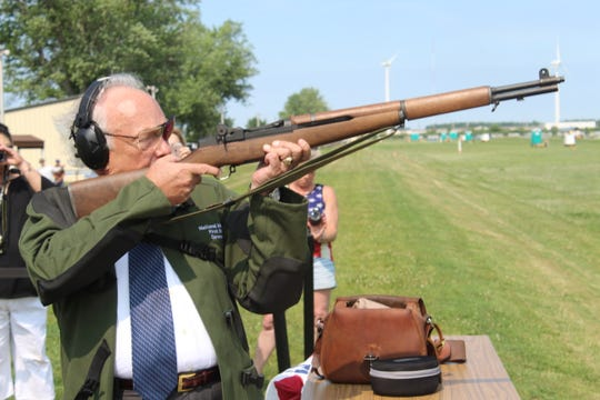 Cris Stone sends a bullet into a target hundreds of yards away Monday to open up the national matches at Camp Perry.