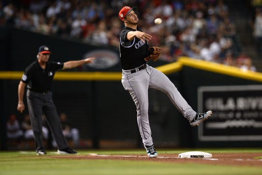 Third baseman Nolan Arenado, shown making a throw to first during a game Sunday at Arizona, and his Colorado Rockies teammates Trevor Story, Charlie Blackmon and David Dahl were all selected to the National League's team for the MLB All-Star Game at 5:30 p.m. Tuesday in Cleveland.