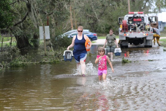 Residents of Buckingham and Lehigh Acres faced flooding and downed trees from Hurricane Irma.  Amanda Inscore/The News-Press Residents of Buckingham and Lehigh Acres faced flooding and downed trees from Hurricane Irma.