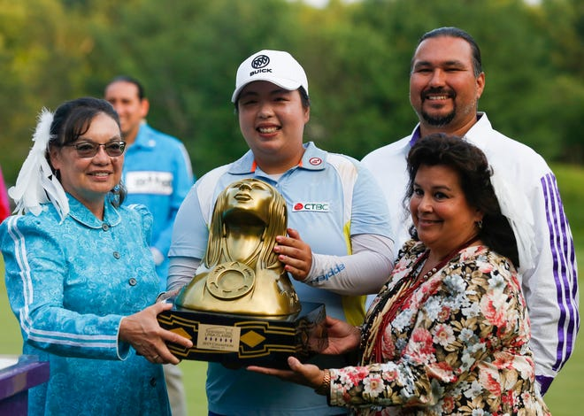 Shanshan Feng of China poses with the Thornberry Creek LPGA Classic trophy after winning the tournament July 7 in Hobart.