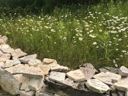 Write On, Door County's expanded area will have stone walls lining its entrance. At the groundbreaking, people wrote messages and words on a few to signify the new chapter.