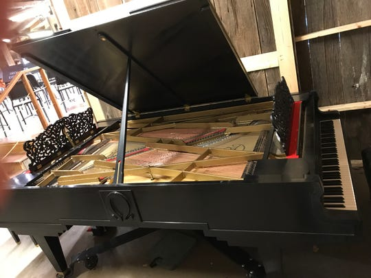 Peter Nehlsen of Washington Island built by hand this double grand piano which will be played in concert July 11 and 12 at Birch Creek Music Performance Center. It's one of just two double pianos known to be working in the world.