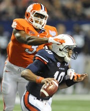 Vic Beasley (3) had 30 stacks, including this one of Auburn quarterback Kiehl Frazier (10) in 2012, during his Clemson career.