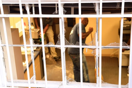 Cleanup in progress Monday, July 8, 2019, after windows at the courthouse in Pickens County were shattered by, what the sheriff's office says, were explosions caused by pipe bombs on late Sunday night.