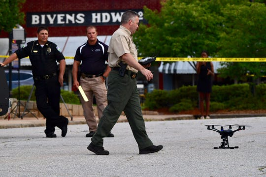 Pickens County sheriff Rick Clark uses a drone over the courthouse in downtown Pickens on Monday, July 8, 2019, after homemade devices were detonated overnight by unidentified suspects.