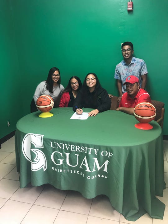 Louise Baza, center, signs with the University of Guam women's basketball team for 2019-2020. From left: Hannah Camacho, friend, Fely Baza, mother, Baza, John Baza, brother, Stephen Baza, father.