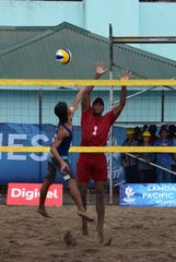 Zak Zacarias reaches high to get the ball against Tonga during a beach volleyball match July 8, 2019 at the Apia waterfront during the 2019 Pacific Games.