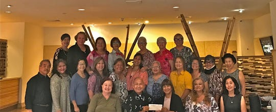 The Guam Sunshine Lions Club participated in the American Cancer Society's Relay for Life (Familias for Life) by donating $200 on May 24. President Pete Babauta presented the check to Lion Mary Taitano, Familias for Life club coordinator. Seated from left: Lions Doris Cruz, Babauta, Taitano, LouJean Borja, and Linda Villagomez. Second row: Lions Johnny Villagomez, Lorraine Rivera, Sera Taitano, Clarice Quichocho, Jojo Pillsbury, Tish Tano, Helen Colby, Julie Cruz, Dot Leon Guerrero, Josephine Borja, and Tiger Kim. Back row: Lions Marietta Camacho, Maggie Aguon, Flo Terlaje, Sid Weedin, Jovie Mejorada, Helen Mendiola, and Jill Pangelinan.