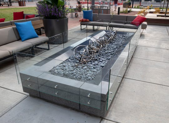 The fire pit is as long as a couch.