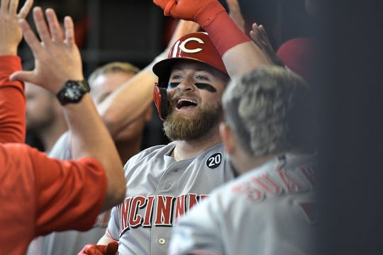 May 22, 2019; Milwaukee, WI, USA; Cincinnati Reds catcher Tucker Barnhart (16) celebrates in the dugout after hitting a three run home run against the Milwaukee Brewers in the second inning at Miller Park. Mandatory Credit: Michael McLoone-USA TODAY Sports