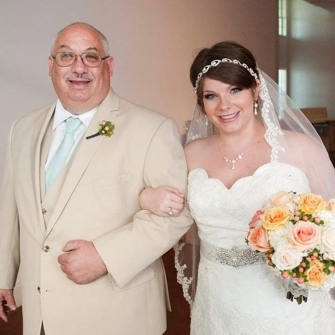 Charles Ponthieux with his daughter Emilie McEachern at her wedding.