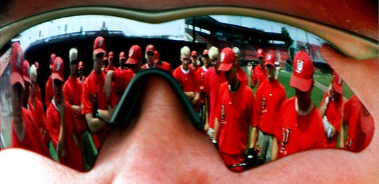 The Rajun Cajun Baseball team is reflected in the eye's of their Head Coach Tony Robichaux as he talks to them about the task ahead. The Cajun's will begin their quest to return to the College World Series in Omaha Nebraska on Friday in Baton Rouge in a game against Tulane. John Rowland/The Advertiser