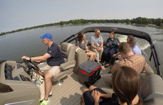 With David Howard at the helm Monday, July 8, 2019, U.S. Rep. Elissa Slotkin talks about PFAS as they navigate the Chain of Lakes on which the Howard family lives.