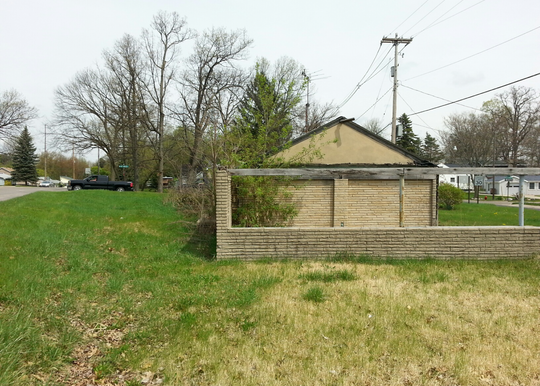 An undated photo of the Haslett tirangle property before it became a sculpture garden that was dedicated June 29, 2019.