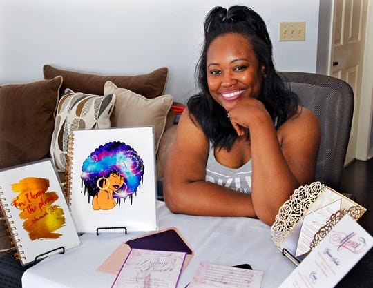 Star McMurtry, owner of Taylor Designer & Stationary, displays some of her designs at her Franklin home.