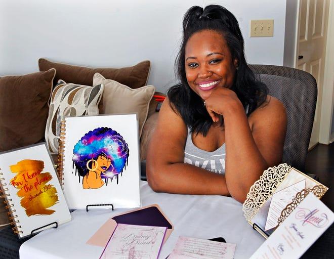 Star McMurty, owner of Taylor Designer & Stationary, displays some of her designs at her Franklin home.