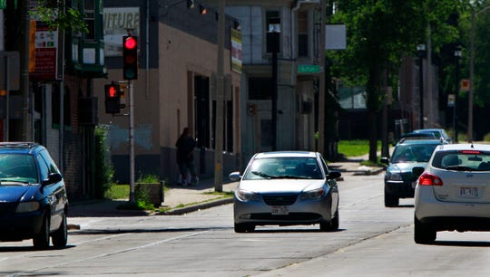 A car goes through a red light at East Center and North Holton streets one day last week. Nearby residents have complained of excessive speeds, accidents and cars running through traffic signals.