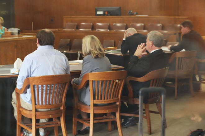 Jordan Fricke, seated left, is brought into a Milwaukee County courtroom briefly with attorney Patricia Bradford, center, and Michael Chernin, right, as jury selection begins July 8, 2019.