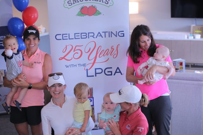 (From left to right) LPGA golfer Gerina Piller and former Tour members Danah Bordner and Stacy Lewis, along with Beth Hutter, pose for a photo with their children.