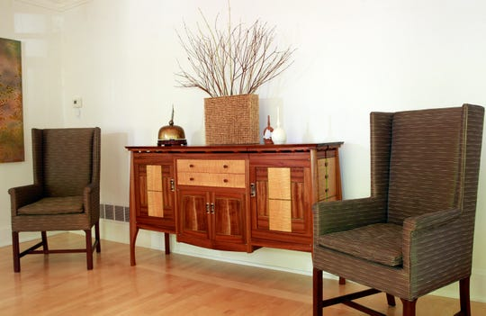 A sideboard in the dining room is made from mahogany and sapele wood from Africa.
