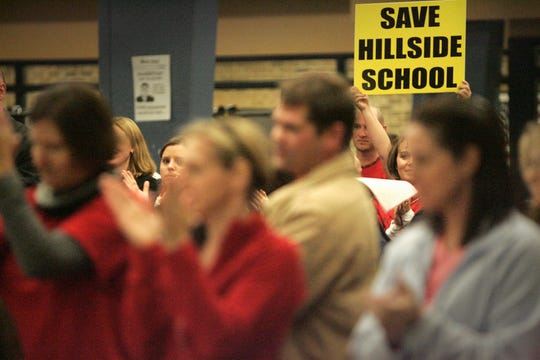 Supporters of keeping Hillside Elementary School open gave one of the speakers a standing ovation during an Elmbrook School Board meeting in this October 2011 photo. Hillside closed after the 2011-12 school year but could be reopened as a way for the district to address anticipated enrollment growth.